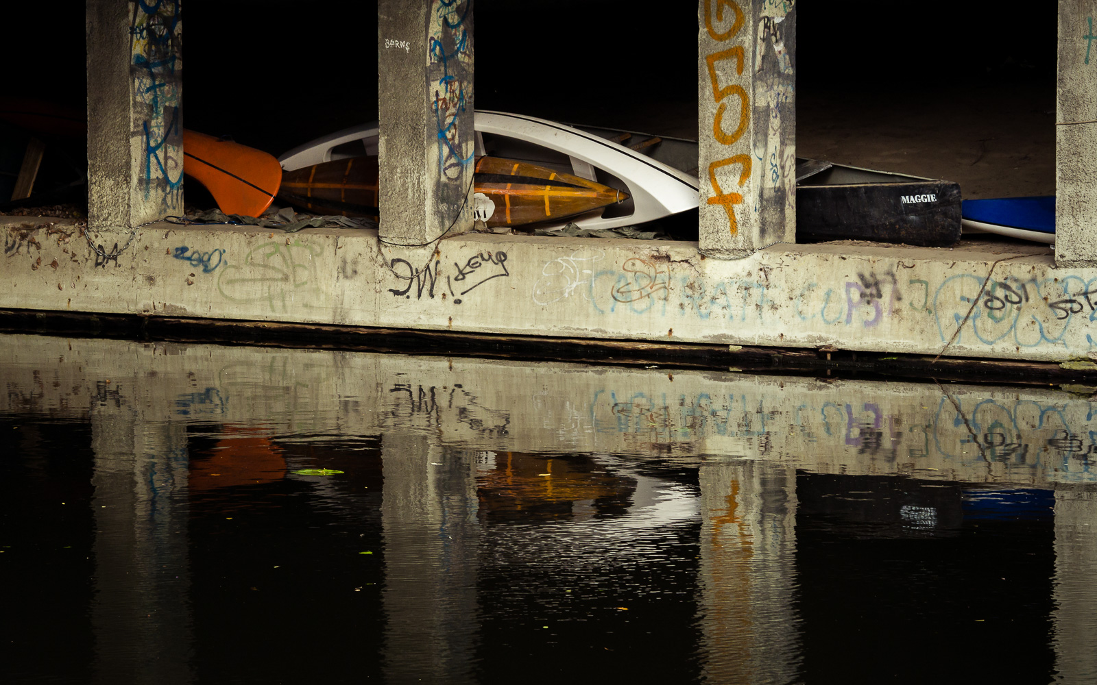 Boats stored under a bridge in Hamburg